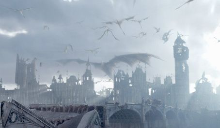 Reign of Fire A dragon with a 300-foot wide wingspan and its offspring fly high over the ruins of London, having burnt Big Ben and Parliament to ash in Touchstone's  - 2002