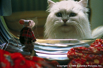 Stuart Little A natural enemy of this unwelcome new member of the family, Snowbell the cat (voiced by Nathan Lane) contemplates the pros and cons of saving Stuart (voiced by Michael J. Fox) from certain disaster in the washing machine in the Columbia Pictures presentat