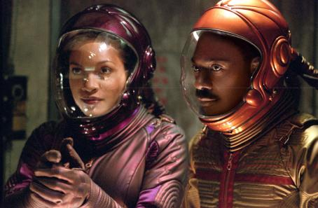 The Adventures of Pluto Nash Rosario Dawson and Eddie Murphy in  - 2002