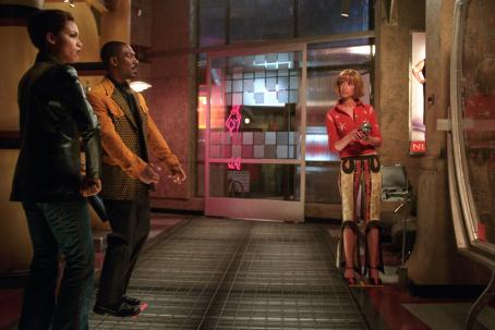 Illeana Douglas Rosario Dawson, Eddie Murphy and  in The Adventures of Pluto Nash - 2002