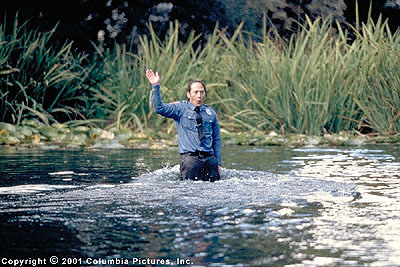 Rob Schneider Marvin Mange () proudly frolics in the water like a dolphin after saving a little boy's life in the Revolution Studios/Columbia Pictures release, The Animal - 2001