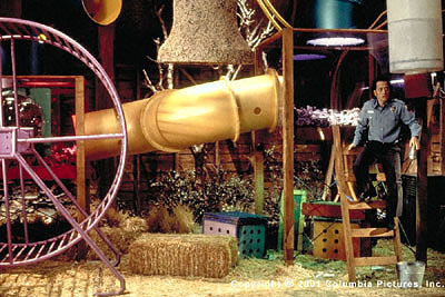 Rob Schneider Marvin Mange () explores his new living quarters-complete with human-size hamster wheel-in Dr. Wilder's lab in the Revolution Studios/Columbia Pictures release, The Animal - 2001
