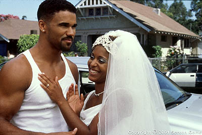 Shemar Moore Terry () and fiancée BeBe (Susan Dalian) work out pre-wedding jitters in Gary Hardwick's The Brothers from Screen Gems - 2001