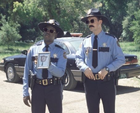 The Country Bears When Beary sets off to reunite the band, two clueless cops, Officers Hamm (Daryl Mitchell, left) and Cheets (Diedrich Bader, right) get on the case in Walt Disney's  - 2002