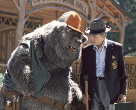 The Country Bears Big Al (left), longtime caretaker of Country Bear Hall, gives the lowdown to Reed Thimple (Christopher Walken, right), an evil banker determined to destroy the legendary venue in Walt Disney's  - 2002
