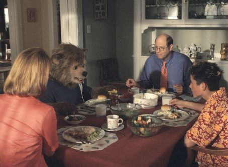 Beary (center left) breaks bread with his overbearing family – his mother (Meagen Fay, left), father (Stephen Tobolowsky, center right), and brother, Dex (Eli Marienthal, right) in Walt Disney's The Country Bears - 2002