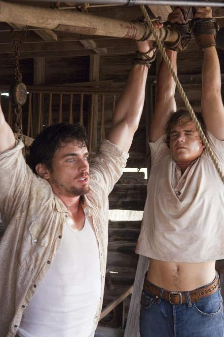 "Matt Bomer (left to right) Matthew Bomer as ""Eric"" and Taylor Handley as ""Dean"" in New Line Cinema's Texas Chainsaw Massacre: The Beginning. Photo Credit: 2005 Van Redin/New Line Productions"