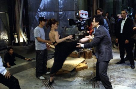 Ritchie Coster Jennifer Love Hewitt get some help from Jackie Chan on one of her high-kicking moves, as director Kevin Donovan (rear center) and star  (rear right) watch in Dreamworks' The Tuxedo - 2002