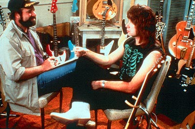Christopher Guest Filmmaker Marty DiBergi (Rob Reiner) talks with Nigel Tufnel () on the set of his definitive rockumentary in This Is Spinal Tap - 1984, re-released by MGM in 2000