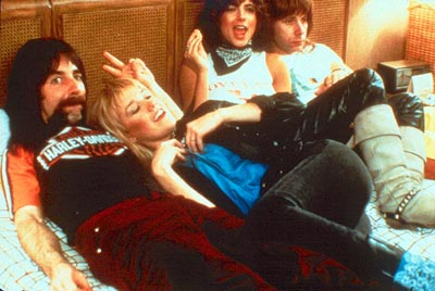 Christopher Guest Derek Smalls (Harry Shearer) and Nigel Tufnel () with some of their illustrious groupies in This Is Spinal Tap - 1984, re-released by MGM in 2000