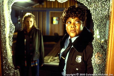 Loretta Devine Reese (, left), campus security guard at Alpine University, sizes up the latest in a series of 'accidents' that plagues the school's Hitchcock award competition and terrifies aspiring filmmaker Amy (Jennifer Morrison) in Columbia