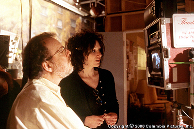 Amy Heckerling Director  and first assistant director 'J.J.' Jeff Authors collaborate during the filming of Columbia's Loser - 2000