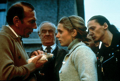 Rat Hubert (Pete Postlethwaite) shows his rat to Uncle Matt (Frank Kelly), Marietta (Kerry Condon) and the others in Universal Focus'  - 2001