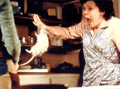 Rat Conchita (Imelda Staunton) is bitten by her husband in the form of a white rat in Universal Focus'  - 2001