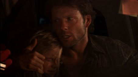 Jamie Bamber Justine (Karley Scott Collins) hug by Stephen () in Dimension Extreme and Genius Products' Pulse 2: Afterlife.