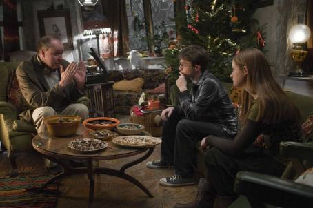 Harry Potter (L-r) Director DAVID YATES on the set with DANIEL RADCLIFFE as  and BONNIE WRIGHT as Ginny Weasley in Warner Bros. Pictures' fantasy ' and the Half-Blood Prince. Photo by Jaap Buitendijk. ©2008 Warner Bros. Entertainment In