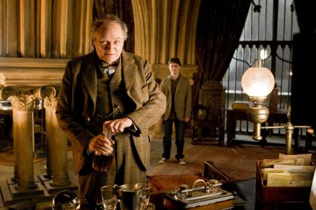 Harry Potter (L-r, foreground) JIM BROADBENT as Professor Horace Slughorn and DANIEL RADCLIFFE as  in Warner Bros. Pictures' fantasy ' and the Half-Blood Prince. Photo by Jaap Buitendijk. ©2008 Warner Bros. Entertainment Inc. - Harry Po