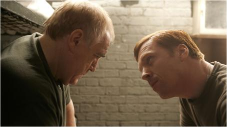 Brian Cox  as Frank Perry and Damian Lewis as Rizza in The Escapist.