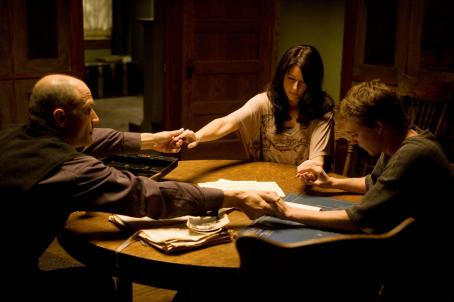 Elias Koteas Popescu (, left), Wendy (Amanda Crew) and Matt (Kyle Gallner) in THE HAUNTING IN CONNETICUT. Photo credit: Allen Fraser.