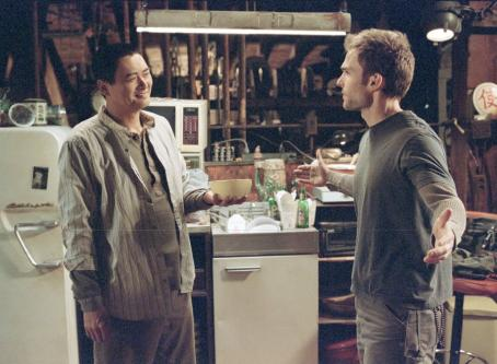 Seann William Scott The Monk (Chow Yun Fat) shows up uninvited in Kar's () apartment