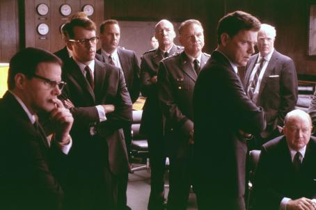 Ed Lauter (left to right) Tim Kelleher (Ted Sorensen), Steven Culp (Robert F. Kennedy), Kevin Costner (Kenny O'Donnell),  (General Marshall Carter), Bill Smitrovich (General Maxwell Taylor), Bruce Greenwood (John F. Kennedy), Peter White (John McCone)