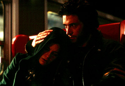 X-Men Logan (Hugh Jackman) comes to the aid of Rogue (Anna Paquin) in 20th Century Fox's  - 2000