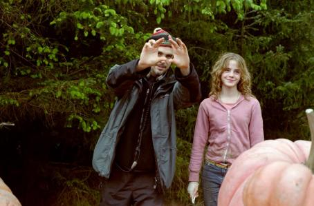 Hermione Granger Director Alfonso Cuarón and Emma Watson as  behind the scenes on the set of Warner Bros. Pictures' 'Harry Potter and the Prisoner of Azkaban.'
