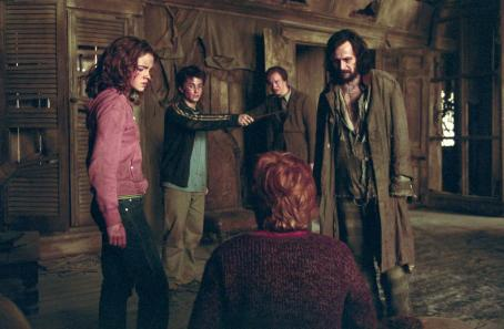 Hermione Granger Emma Watson as , Daniel Radcliffe as Harry Potter, David Thewlis as Professor Lupin, Gary Oldman as Sirius Black and Rupert Grint as Ron Weasley (back to camera) in Warner Bros. Pictures' 'Harry Potter and the Prisoner of Azkaban.&