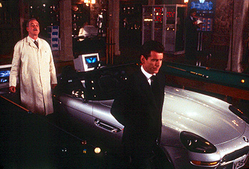 John Cleese  and Pierce Brosnan in MGM's The World Is Not Enough - 11/99