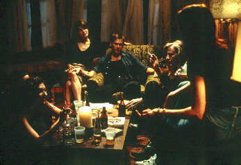 Kevin Bacon and his wife Kathryn Erbe at a neighborhood party, discussing hypnosis in Stir of Echoes