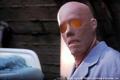 Hollow Man After brilliant and arrogant scientist Sebastian Caine (Kevin Bacon) successfully tests a dangerous, top secret experimental formula for invisibility on himself, he is fitted with a latex mask that allows him to blend into society in Columbia's Hollow