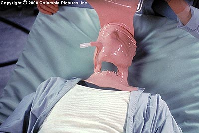 Hollow Man Sebastian Caine (Kevin Bacon) breathes through a plastic air tube while liquid latex is poured over his now invisible head and neck in Columbia's  - 2000