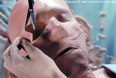 Hollow Man After Sebastian's (Kevin Bacon) latex mask solidifies, eye holes are cut out and other adjustments are made so that the scientist again resembles a human in Columbia's  - 2000