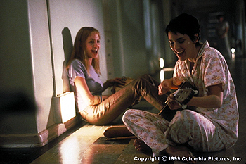 Girl, Interrupted After friend and fellow patient Polly lands herself in solitary, Angelina Jolie (left) and Winona Ryder serenade her in Columbia Pictures' GIRL, INTERRUPTED (12/99)