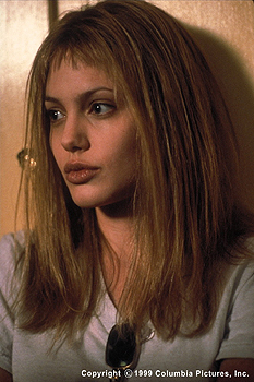 Girl, Interrupted Two-time Golden Globe Award winner Angelina Jolie, a seductive sociopath on the ward who befriends Susanna in the Columbia Pictures presentation, GIRL, INTERRUPTED (12/99)