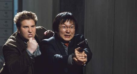 "Masi Oka NATE TORRENCE as Lloyd and MASI OKA as Bruce in Warner Bros. Pictures' and Village Roadshow Pictures' action comedy ""Get Smart,"" distributed by Warner Bros. Pictures. The film stars Steve Carell, Anne Hathaway, Dwayne Johnson and A"