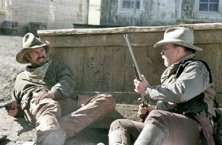 Open Range Charley (Kevin Costner, left) and Boss (Robert Duvall, right) engage in a climactic shootout with ruthless rancher Denton Baxter for control of the city of Harmonville.