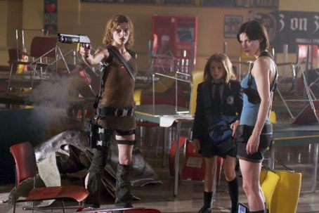 Sophie Vavasseur Milla Jovovich (left),  (center) and Sienna Guillory (right) star in Alexander Witt's Resident Evil: Apocalypse, a Sony Pictures Entertainment release.