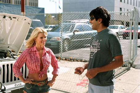 Daisy Duke JESSICA SIMPSON and director JAY CHANDRASEKHAR on location for Warner Bros. Pictures' and Village Roadshow Pictures' action comedy 'The Dukes of Hazzard,' also starring Johnny Knoxville and Seann William Scott and distributed by Warner Bro