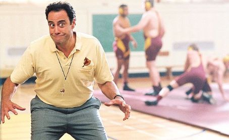 Brad Garrett  as Coach.