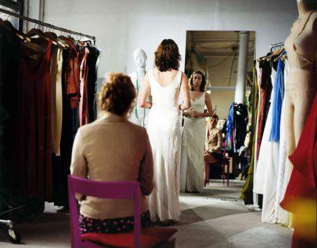 Julianne Nicholson Nicole () is fitted for wedding gown as her best friend Tess (Chelsea Altman) critically consults in a scene from Jeff Lipsky's romantic drama Flannel Pajamas.