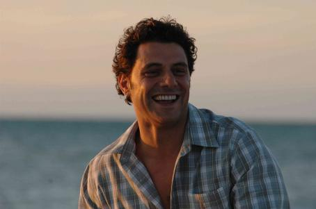 Rex Williamson (Vince Colosimo) on the beach