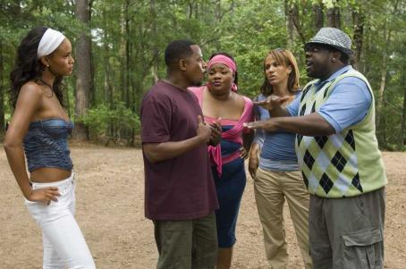 Welcome Home, Roscoe Jenkins (L to R) RJ's fiancée, Bianca (JOY BRYANT), looks on while RJ (MARTIN LAWRENCE) argues with his sister, Betty (MO'NIQUE), first love, Lucinda (NICOLE ARI PARKER), and cousin Clyde (CEDRIC THE ENTERTAINER) in a comedy about a self-help guru who
