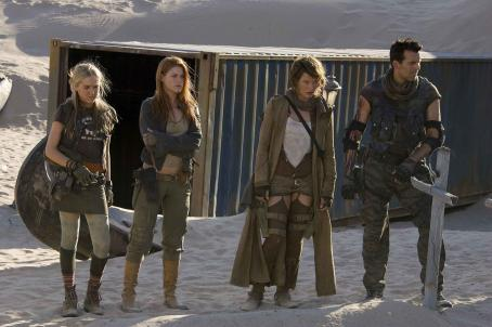 Carlos Olivera (l to r) Spencer Locke, Ali Larter, Milla Jovovich and Oded Fehr in Screen Gems' action/horror film RESIDENT EVIL: EXTINCTION. Photo by: Rolf Konow