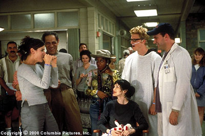 Marianne Jean-Baptiste (Clockwise from left, foreground) Gwen (Sandra Bullock), Daniel (Reni Santoni), Roshanda (), Gerhardt (Alan Tudyk) and Oliver (Mike O'Malley) give Andrea (Azura Skye) a humorous sendoff from rehab in the Columbia Pictures present