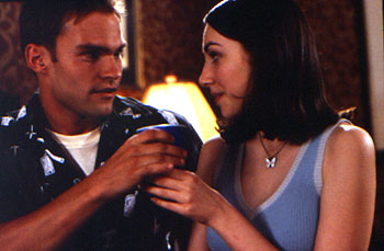 Seann William Scott  tries to convince Eden Riegel that he truly cares about her in Universal's American Pie - 1999