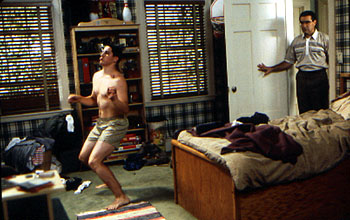 Eugene Levy Jason Biggs dances towards manhood without knowing that  is looking on in Universal's American Pie - 1999