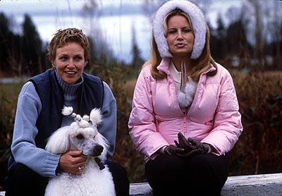 Best in Show While Sherri Ann Cabot (Jennifer Coolidge, right), is confident that her two-time champion Standard Poodle, Rhapsody In White, will keep the crown, she isn't taking any chances and has hired ace handler Christy Cummings (Jane Lynch, left) to assure he