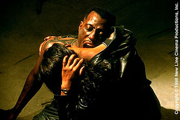 Wesley Snipes  as Blade feasting on Karen (N'Bushe Wright) to power himself for the final battle in New Line Cinema's Blade - 1998