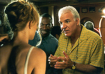 Bowfinger Steve Martin explains the upcoming scene to Heather Graham while Eddie Murphy eagerly grins in anticipation